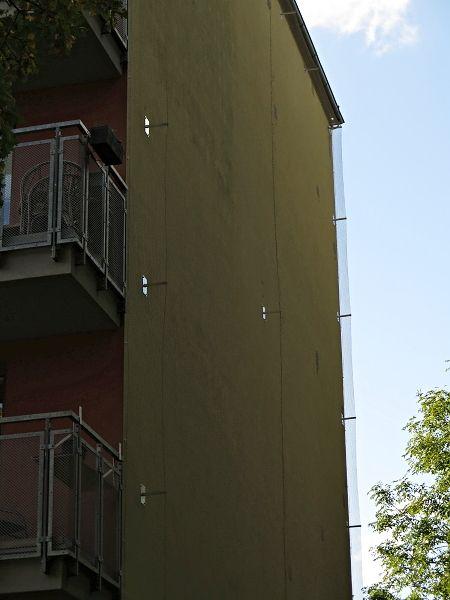 Zasíťování zateplené fasády proti ptactvu